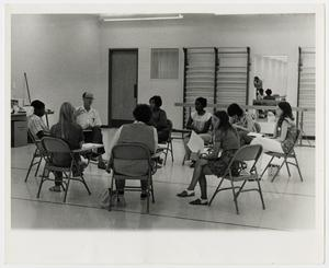 Primary view of object titled '[Photograph of Students Sitting in a Circle]'.
