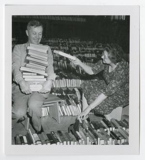 Primary view of object titled '[Photograph of Library Staff Moving Books]'.