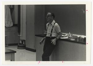 Primary view of object titled '[Photograph of Dr. Richard Moore Teaching]'.