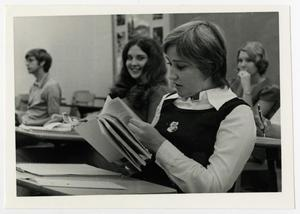Primary view of object titled '[Photograph of Debby Baker Reading a Book in Class]'.