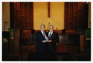 Primary view of object titled '[Photograph of Man Receiving Award]'.