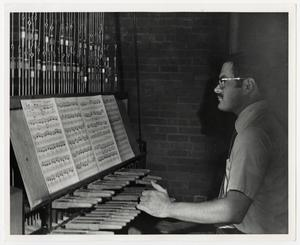 Primary view of object titled '[Photograph of Man Playing Carillon]'.