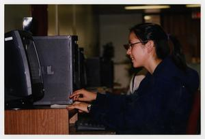 Primary view of object titled '[Photograph of Student Working on Computer]'.