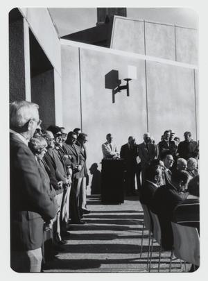 Primary view of object titled '[Photograph of Speaker at Campus Center Ribbon Cutting]'.