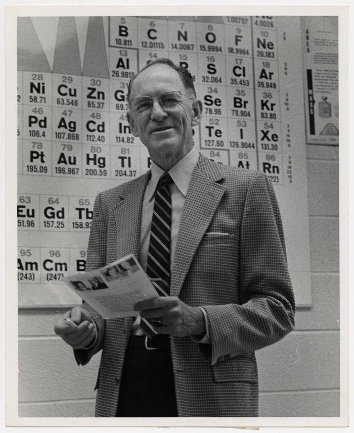 Photograph Of Dr W Norton Jones Jr And Periodic Table The