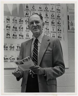 Primary view of object titled '[Photograph of Dr. W. Norton Jones, Jr., and Periodic Table]'.