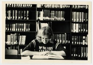 Primary view of object titled '[Photograph of Student in Jay-Rollins Library]'.