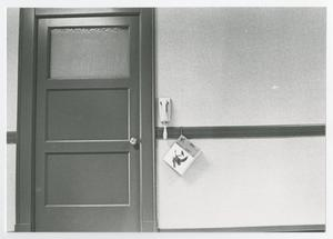 Primary view of object titled '[Photograph of Door and Wall Phone]'.