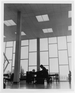 Primary view of object titled '[Photograph of Student Studying in McMurry Library]'.