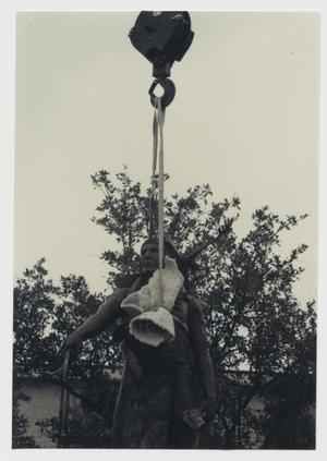 Primary view of object titled '[Photograph of Crane Lifting Sacred Wind]'.