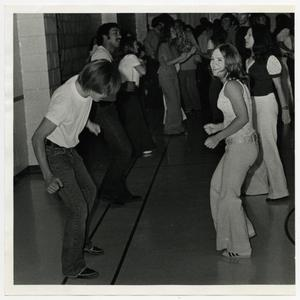 Primary view of object titled '[Photograph of Students Dancing in Hallway]'.