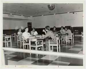 Primary view of object titled '[Photograph of Students Relaxing in the Dining Hall]'.