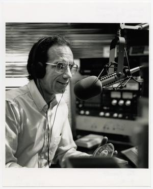 Primary view of object titled '[Photograph of Joe Specht at a Microphone]'.