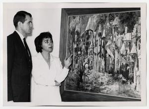 Primary view of object titled '[Photograph of Couple Looking at Painting]'.