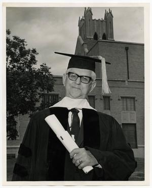 Primary view of object titled '[Photograph of Basil E. Ryan in Cap and Gown]'.