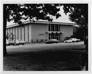 Primary view of object titled '[Photograph of Maedgen Administration Building from the Parking Lot]'.
