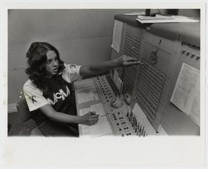 Primary view of object titled '[Photograph of Student at Switchboard]'.