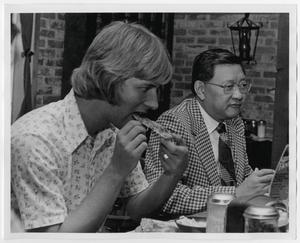 Primary view of object titled '[Photograph of Dr. Thomas Kim Eating with Students]'.