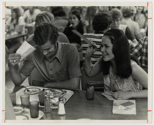 Primary view of object titled '[Photograph of Students at Cafeteria Table]'.