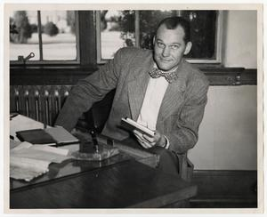 Primary view of object titled '[Photograph of Garnet Gracy Sitting at Desk]'.