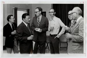 Primary view of object titled '[Photograph of Dr. Thomas Kim at a Meeting]'.