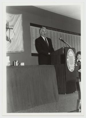 Primary view of object titled '[Photograph of Dr. James Kirby Speaking]'.
