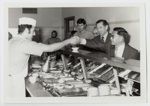 Primary view of object titled '[Photograph of Dr. Kim in a Cafeteria]'.
