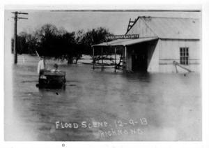 Primary view of object titled '[Photograph of Man Driving in Flood Waters]'.