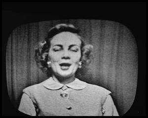 Primary view of object titled 'Woman On Television'.