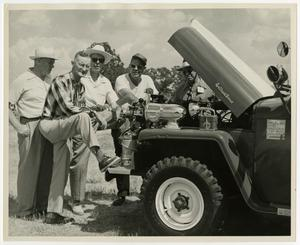 Primary view of object titled '[Men Standing by Jeep]'.