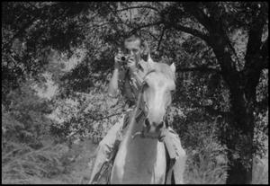 Primary view of object titled '[Photograph of Larry Jene Fisher on a Horse]'.