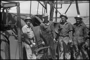 Primary view of object titled '[Photograph of Oil Drilling Crew]'.