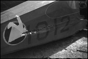 Primary view of object titled '[Photograph of Damaged Plane Hull]'.