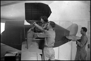 Primary view of object titled '[Photograph of Woman in Flight Simulator]'.