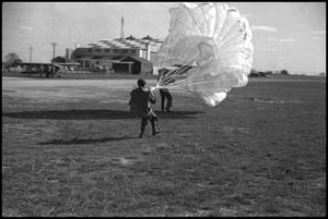 Primary view of object titled '[Photograph of Man with Parachute]'.
