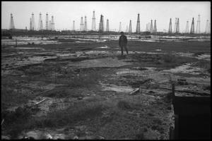 Primary view of object titled '[Photograph of Man at Lucas Gusher Site]'.