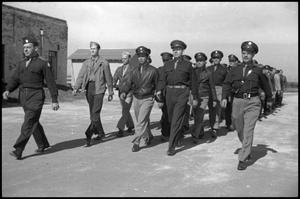 Primary view of object titled '[Photograph of Civil Air Patrol Members Marching]'.