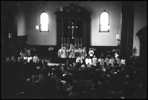 Primary view of object titled '[Photograph of St. James Catholic Church Mass]'.