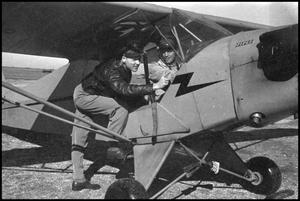 Primary view of object titled '[Photograph of Men in Airplane]'.