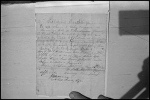 Primary view of object titled '[Photograph of Confederate Soldier Discharge Paper]'.