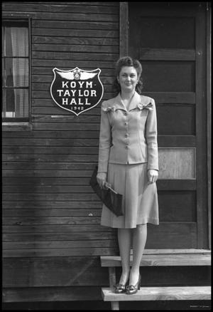 Primary view of object titled '[Photograph of Woman at Koym-Taylor Hall]'.