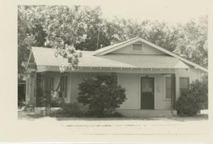 Primary view of object titled '[Photograph of House with Window Air Conditioner]'.