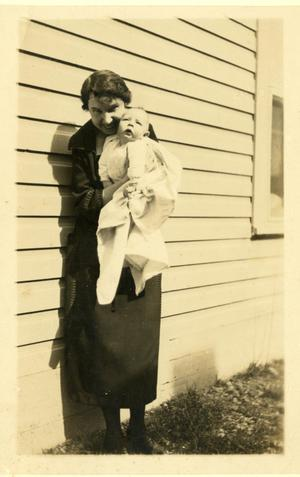 Primary view of object titled '[Photograph of Inez Norton with a Baby]'.