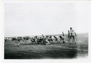 Primary view of object titled '[Photograph of Football Team and Crowd]'.