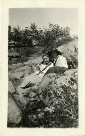 Primary view of object titled '[Photograph of Alta Wood and Lois Kelley on Rock]'.