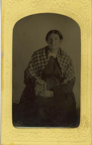 Primary view of object titled '[Portrait of Older Woman with Picture Frame]'.