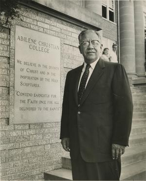 Primary view of object titled '[Photograph of Don H. Morris with Cornerstone]'.