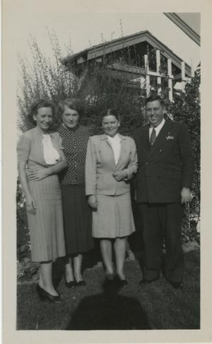 Primary view of object titled '[Photograph of Group in Front of Trellis]'.