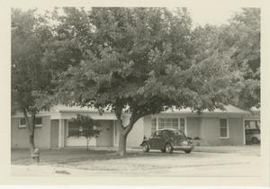 Primary view of object titled '[Photograph of House with VW Bug]'.