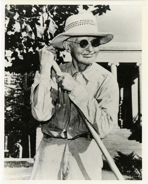 Primary view of object titled '[Photograph of J.S. Burgess with Garden Rake]'.